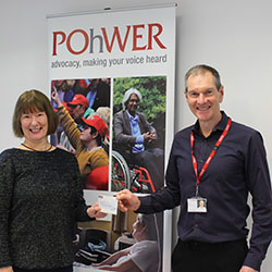 Margie Gibbs presenting fundraised money cheque to Mark Lister