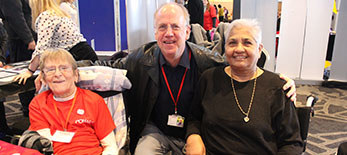 A photo of Vice Presidents Aruna and Judith with our Trustee Geoff