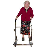 An elderly lady using a frame to walk.