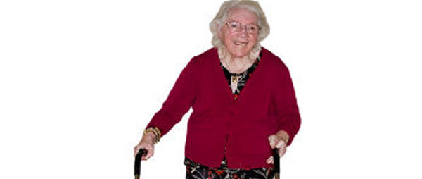 A picture of an elderly lady who is using a frame to walk.
