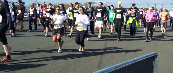 A staff member doing a 10k run for POhWER