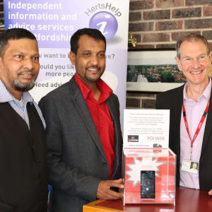 Abbas and his partner with Mark Lister at the Community Advice Phone launch event